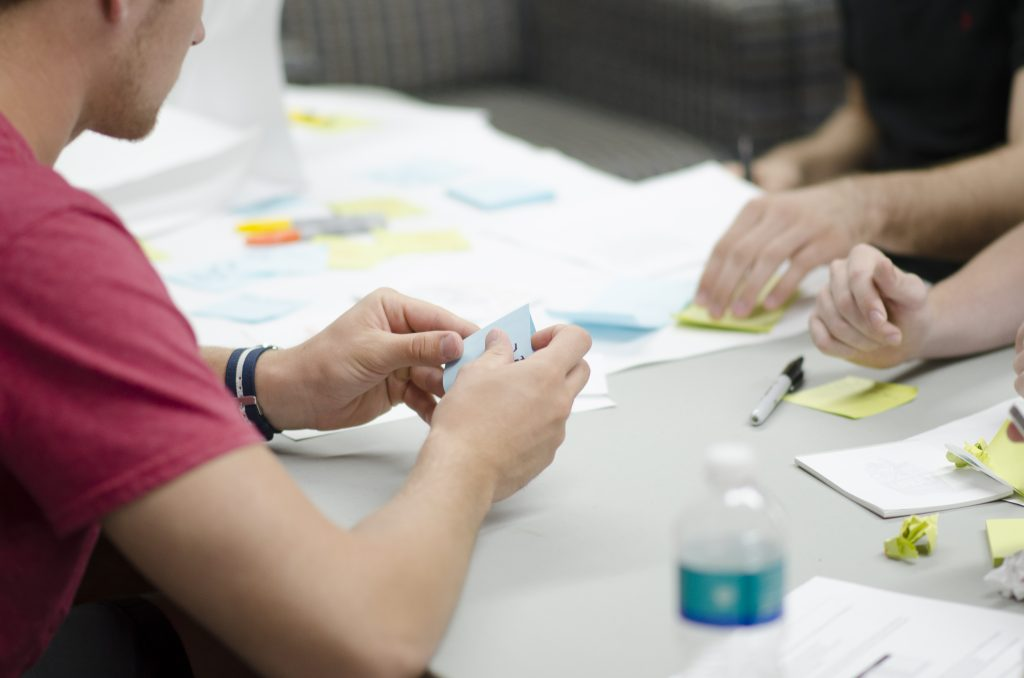 Man using post it notes for Agile Development
