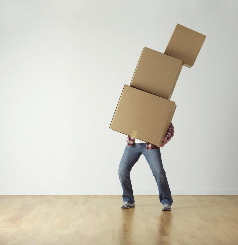 Not getting Done Done, Top 5 Causes of Sprint Carryover - Man carrying boxes