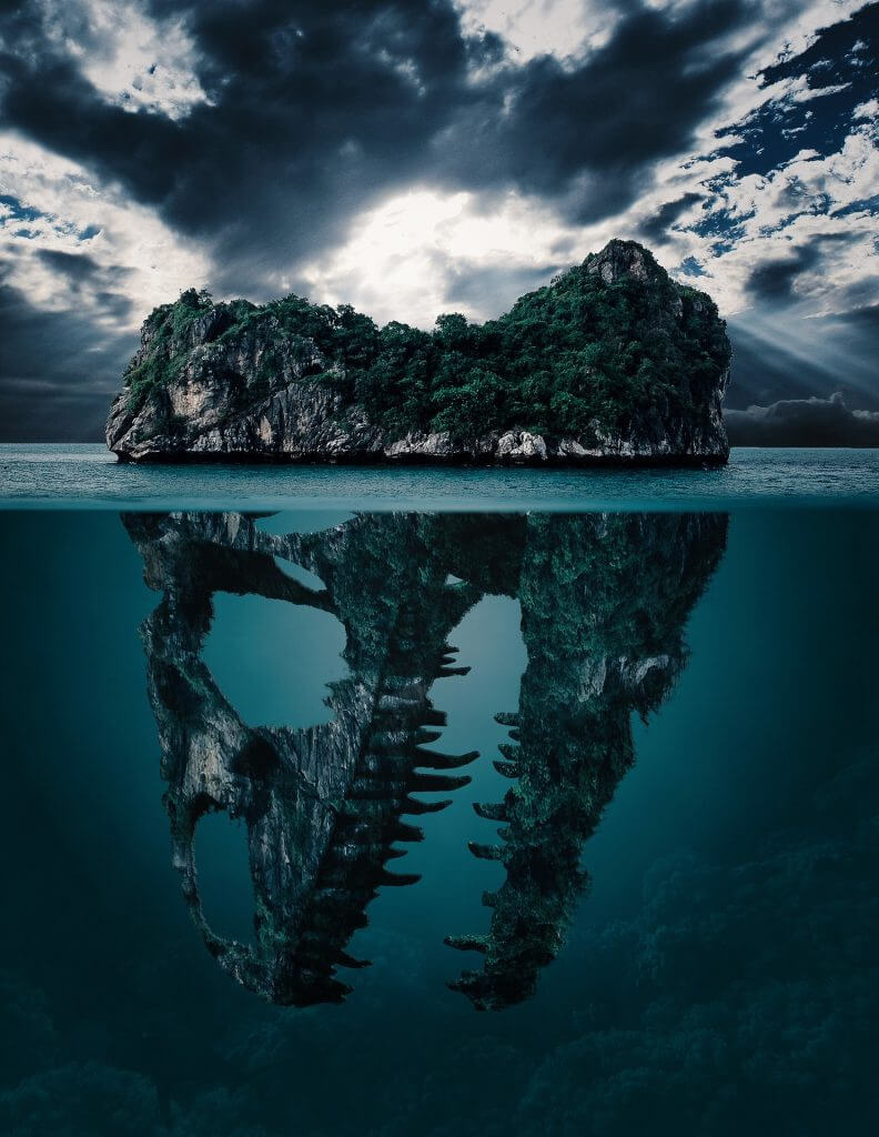 Hidden project plan represented through an island that is actually a skull underwater. - Fight it with Agile