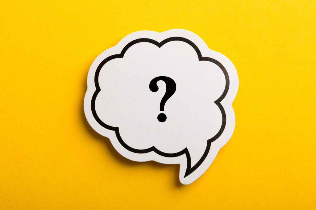 A single question mark in a thought bubble is against a solid yellow background, representing the most important question to ask for a successful Agile transformation. For leaders during an Agile transformation, the question of why the organization is going Agile is vital. Without this compelling reason for change, the transformation runs the risk of losing steam and failing.