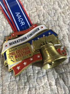 Andy's medal showing he completed the Philly AACR, his second full marathon.